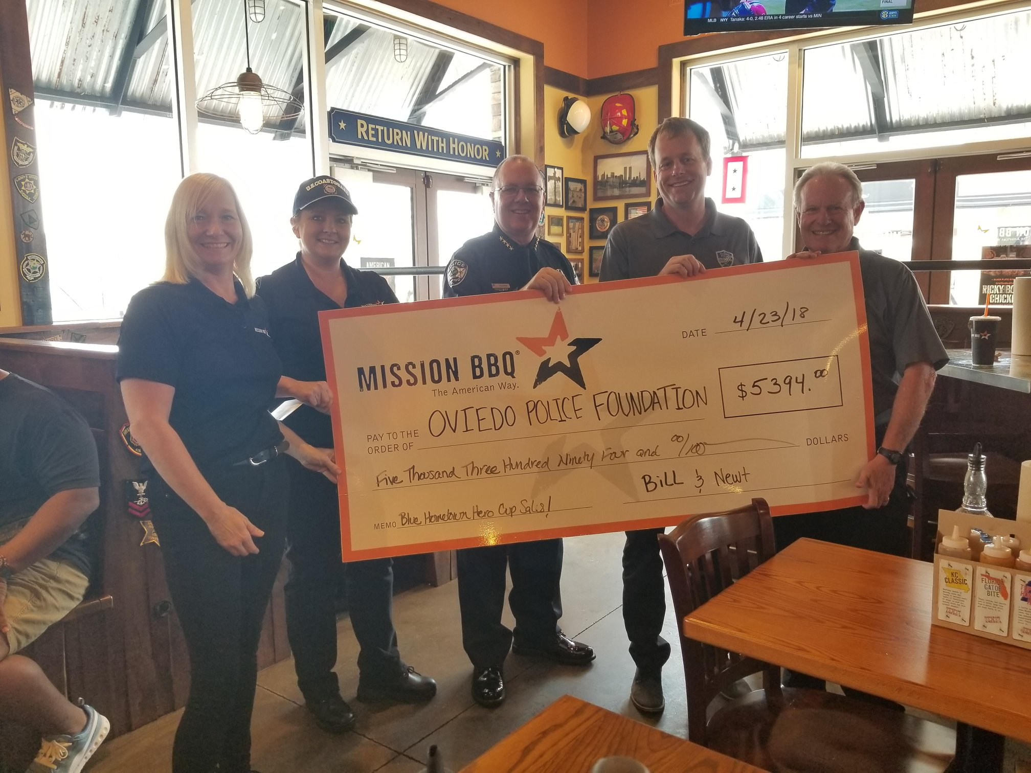 Beers & Gordon donating to the Oviedo Police Foundation